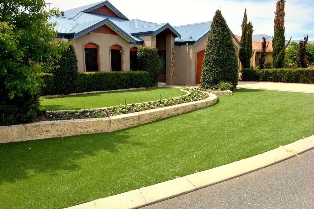 artificial lawn on two levels in front yard of house