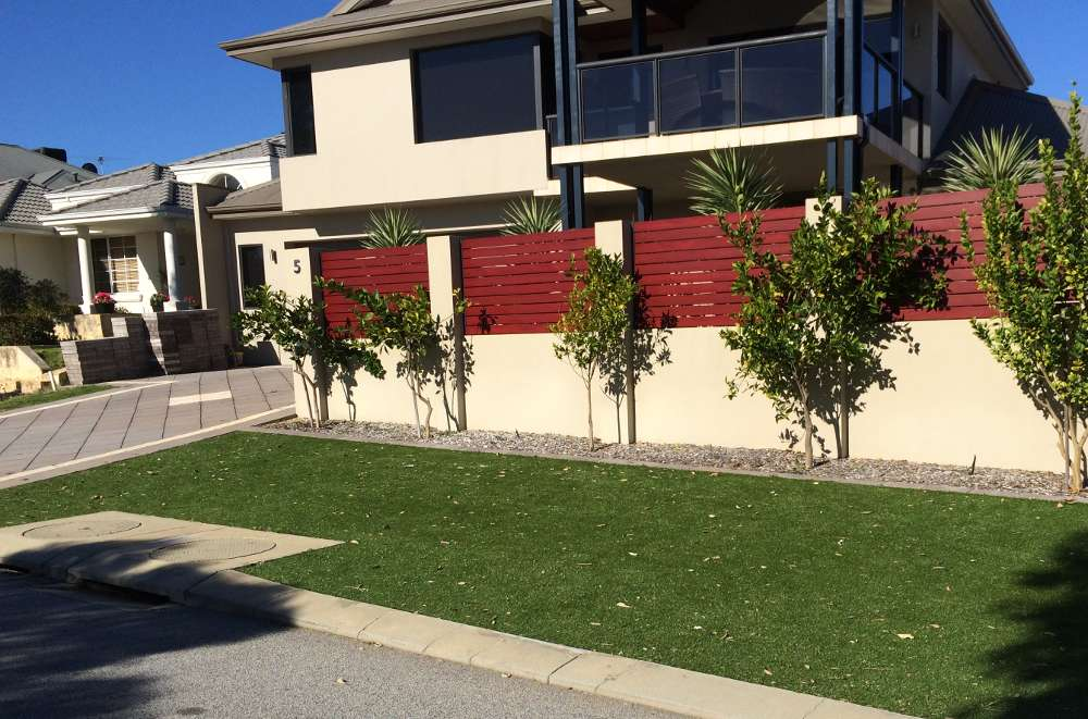 artificial lawn on the verge alongside side of a house