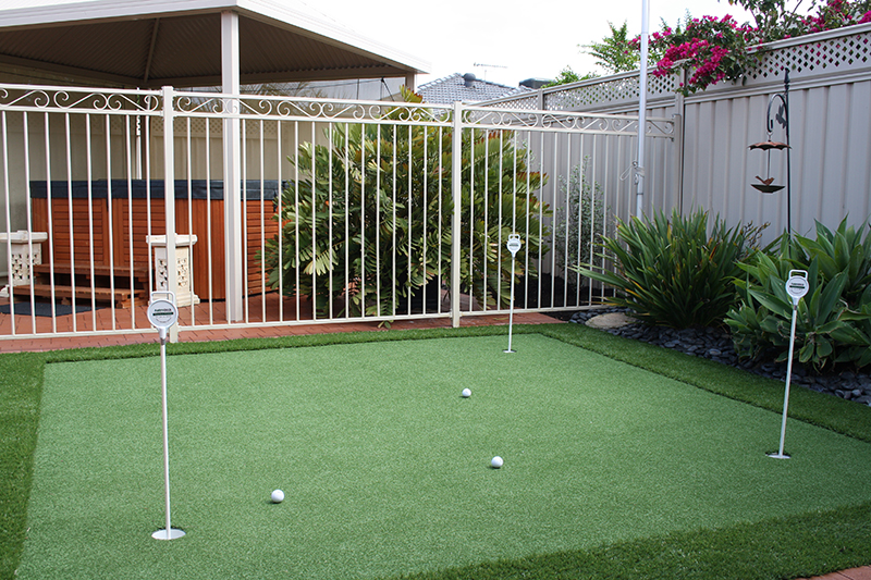 artificial turf putting green with three cups