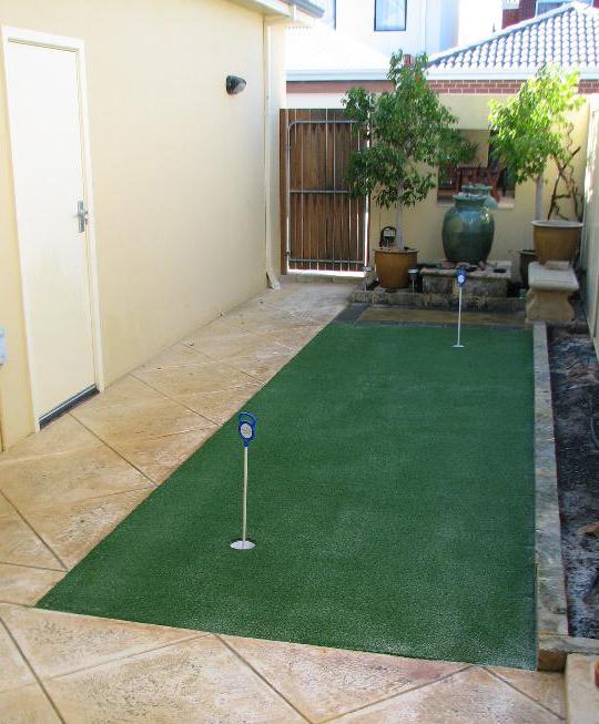 artificial turf putting green side of house